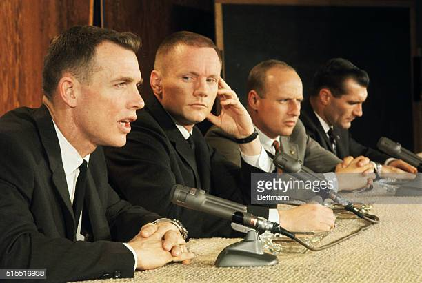 Space Center, Houston, Texas: Gemini 8 astronauts and back up crew answer questions concerning the upcoming space mission at a press conference. The...