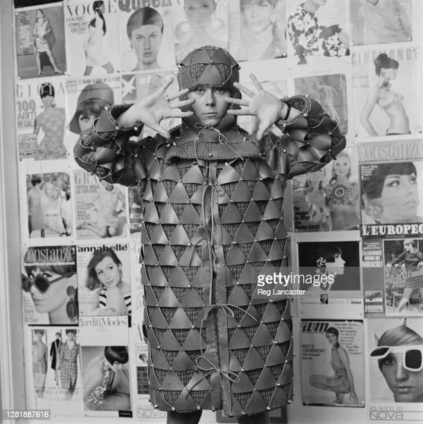 Space' coat made of metal plates by Khank, during a Paris fashion show, France, 28th July 1966.