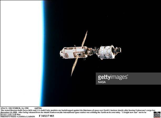 Space / December 1998 The Mated Russian-Built Zarya And U.S.-Built Unity Modules Are Backdropped Against The Blackness Of Space Over Earth's Horizon...