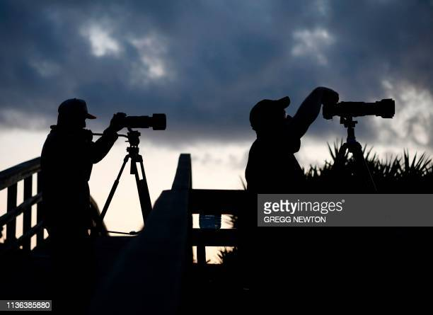 Space enthusiasts photograph the SpaceX Falcon Heavy rocket before dawn near the Kennedy Space Center in Florida on April 11 2019 This vantage point...