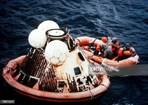 Space Exploration Apollo 11 The splashdown of the Apollo 11astronauts as they are pictured in the dinghy on the 24th July 1969 Apollo 11 with it's...