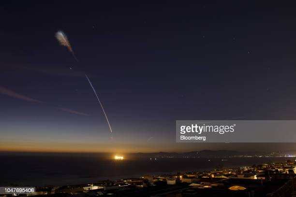 A Space Exploration Technologies Corp Falcon 9 rocket flies above Manhattan Beach California on Sunday Oct 7 2018 Elon Musk's rocket company launched...