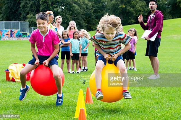 space hopper challenge - bouncing ball stock photos and pictures