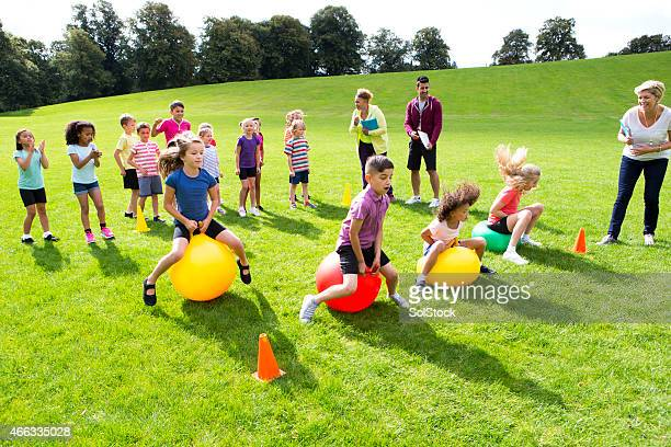 space hopper challenge - hoppity horse stock photos and pictures