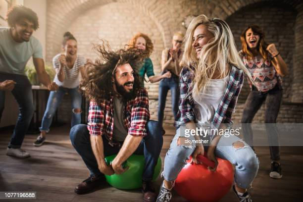 space hopper game at casual office! - bouncing ball stock photos and pictures