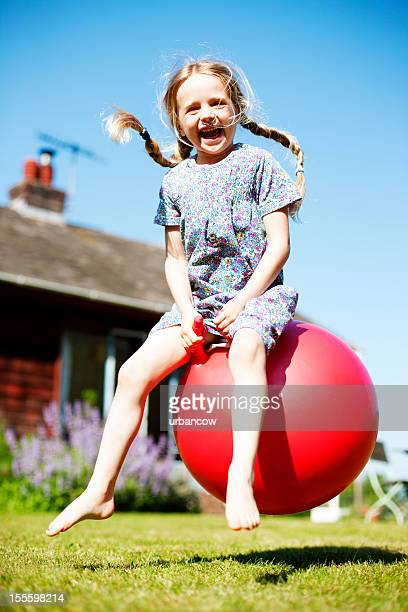 space hopping girl - sports ball stock pictures, royalty-free photos & images