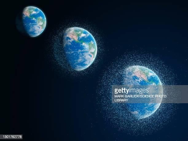 space junk over time, illustration - orbiting foto e immagini stock