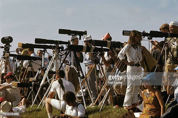 NASA Apollo 11 View of photographers with lens and cameras in press section before spaceflight to moon from Kennedy Space Center on Merritt Island...