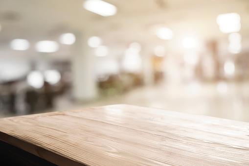 Space of desk over blur cafe background 538477232