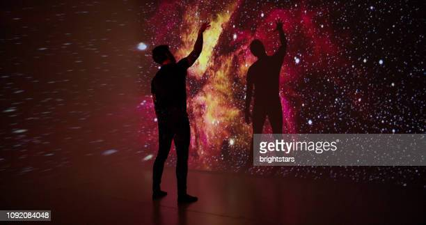 space projection upon a young man - projection stock pictures, royalty-free photos & images