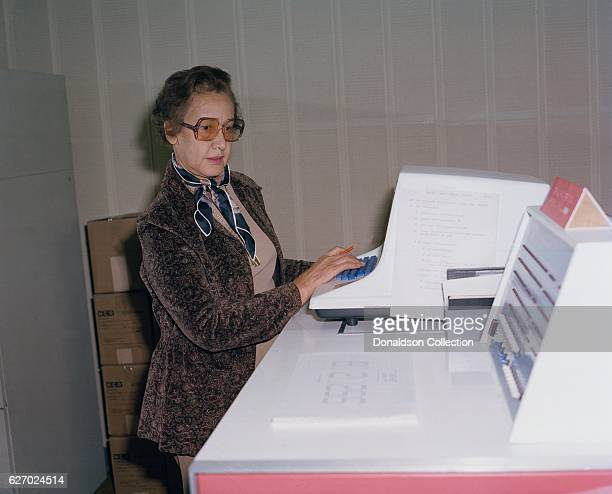 NASA space scientist and mathematician Katherine Johnson poses for a portrait at work at NASA Langley Research Center in 1980 in Hampton Virginia