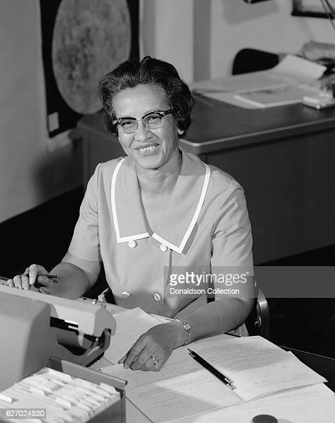 NASA space scientist and mathematician Katherine Johnson poses for a portrait at work at NASA Langley Research Center in 1966 in Hampton Virginia