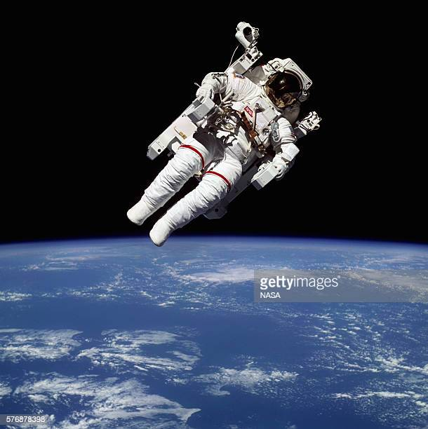 Space shuttle astronaut Bruce McCandless maneuvers through space in a suit designed for individual propulsion | View from Space Shuttle 'Challenger'