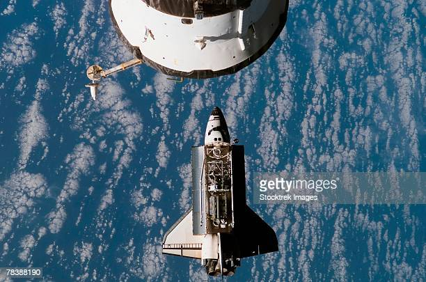 Space Shuttle Atlantis approaches the International Space Station
