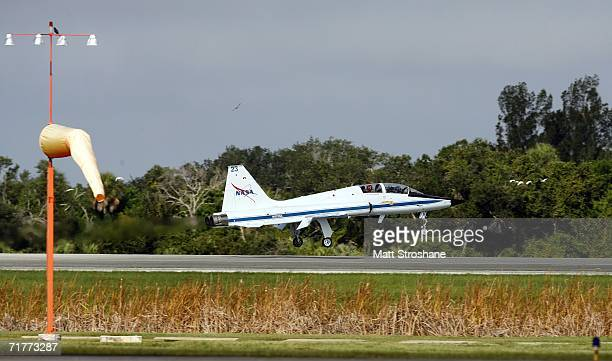 Space Shuttle Atlantis astronauts mission specialists Joseph Tanner and Heidemarie StefanyshynPiper land their T38 jet before addressing the media at...