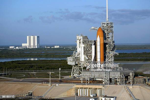 Space shuttle Atlantis atop the mobile launcher platform sits on the launch pad.