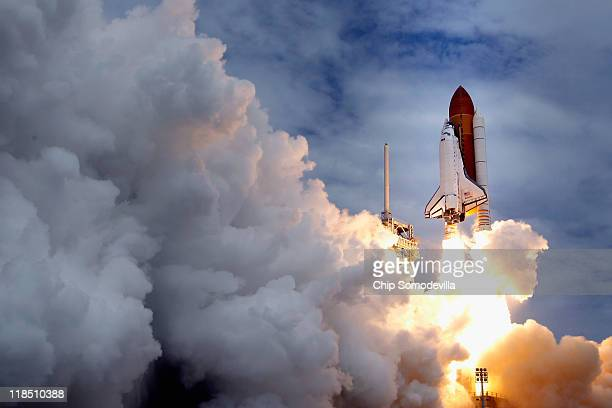Space shuttle Atlantis blasts off from launch pad 39A at Kennedy Space Center July 8, 2011 in Cape Canaveral, Florida. This lift off is the last in...