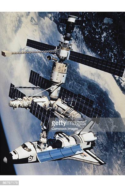 space shuttle atlantis docked to the kristall module - space shuttle atlantis stock pictures, royalty-free photos & images