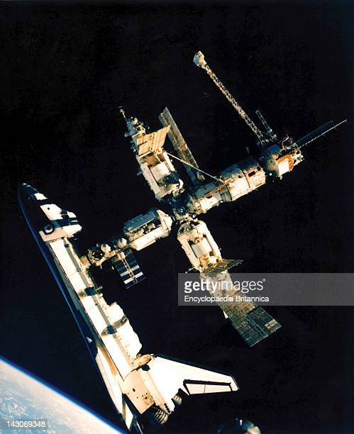 Space Shuttle Atlantis Docks With Mir US Space Shuttle Atlantis Docked With The Russian Space Station Mir In A Photograph Taken By Cosmonaut Nikolay...