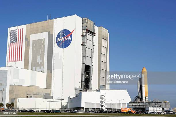 Space Shuttle Atlantis rolls out of the Vehicle Assembly Building atop a crawlertransporter to launch pad 39A at the Kennedy Space Center on February...