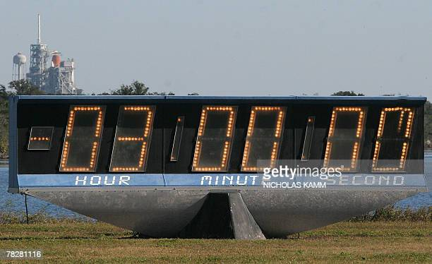 US space shuttle Atlantis sits on the launch pad at Kennedy Space Center behind a stopped countdown clock 06 December 2007 after NASA announced a...