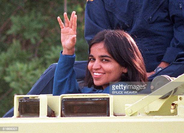 US space shuttle Columbia crewmember Doctor Kalpana Chawla native of Karnal India waves to the media 03 November from the drivers seat of an M113...