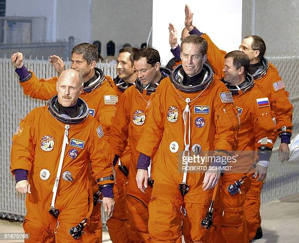 Space Shuttle Commander James Wetherbee and Expedition 6 Commander Kenneth Bowersox lead US astronaut Donald Pettit Russian cosmonaut Nikolai Budarin...