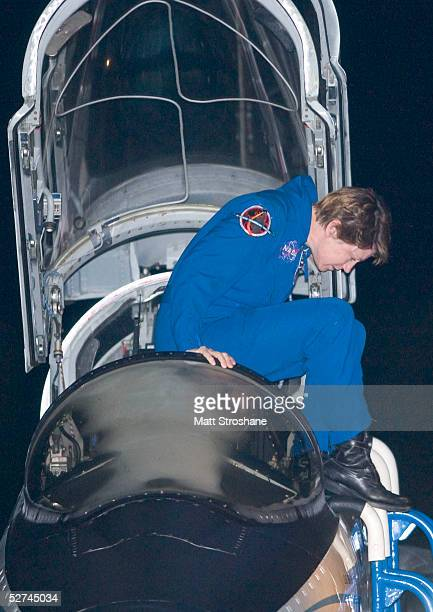 Space Shuttle Discovery Commander Eileen Collins climbs out of her T38 aircraft before addressing the media at the Shuttle Landing Facility at the...