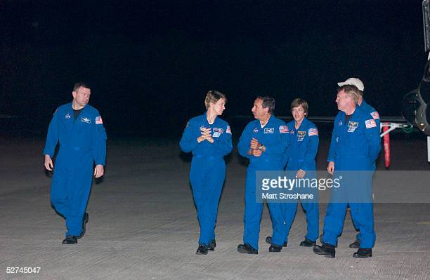 Space Shuttle Discovery Commander Eileen Collins talks with her crew before addressing the media after landing her jet at the Kennedy Space Center's...