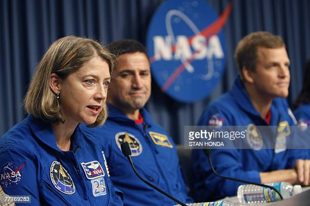 Space shuttle Discovery commander Pamela A Melroy speaks with pilot George D Zamka and mission specialists Scott E Parazynski during press conference...
