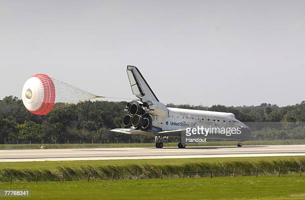 Space Shuttle Discovery deploys a parachutte as it touches down at the shuttle landing facility at Kennedy Space Center November 7, 2007 in Cape...