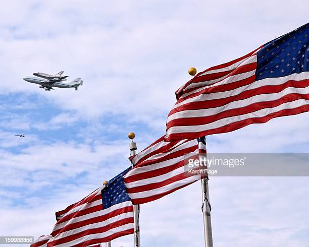 CONTENT] Space Shuttle Discovery is seen in a flyover of the Washington Monument flag ring in Washington DC