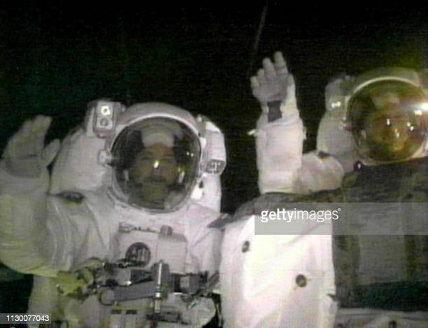US space shuttle Discovery Mission Specialist John Grunsfeld of the US and fellow US Mission Specialist Steve Smith wish everyone a Merry Christmas...
