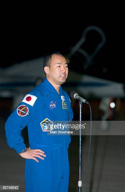 Space Shuttle Discovery mission specialist Soichi Noguchi addresses the media after landing in a T38 aircraft at the Kennedy Space Center's Shuttle...