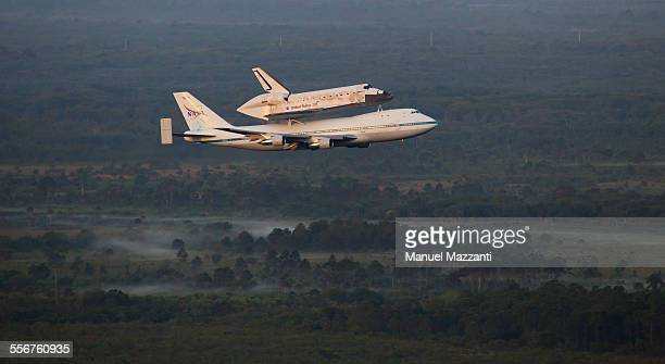 Space Shuttle Discovery on top of the Shuttle Aircraft Carrier leaving the Kennedy Space Center for the last time Discovery is being taken to the...