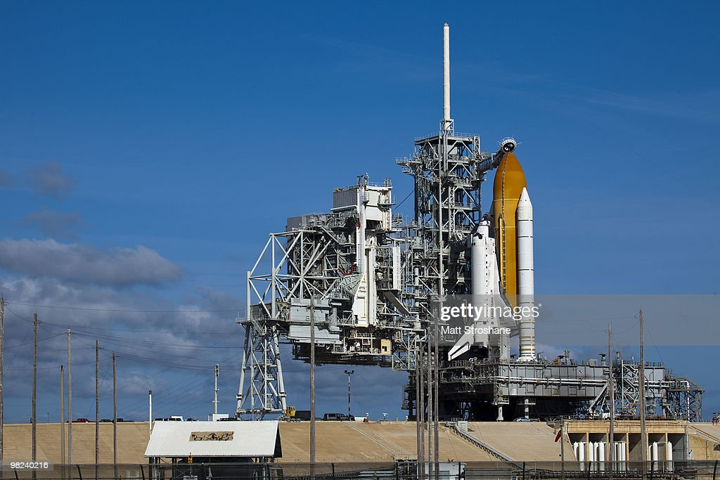 Space Shuttle Discovery sits on launch pad 39-A as the rotating service structure rolls back at Kennedy Space Center on April 4, 2010, in Cape Canaveral, Florida. Discovery is being prepared for a April 5th launch for a mission to the International Space Station.