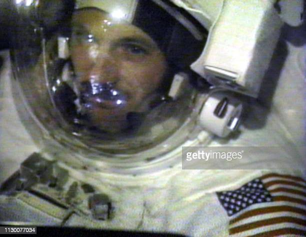 Space shuttle Discovery US Mission Specialist Steve Smith get in close to one of the shuttle's video cameras 24 December 1999 during the third and...