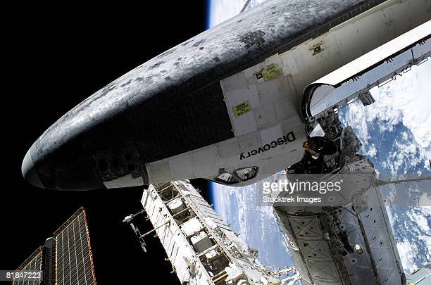 space shuttle docked to the international space station. - space station stock pictures, royalty-free photos & images