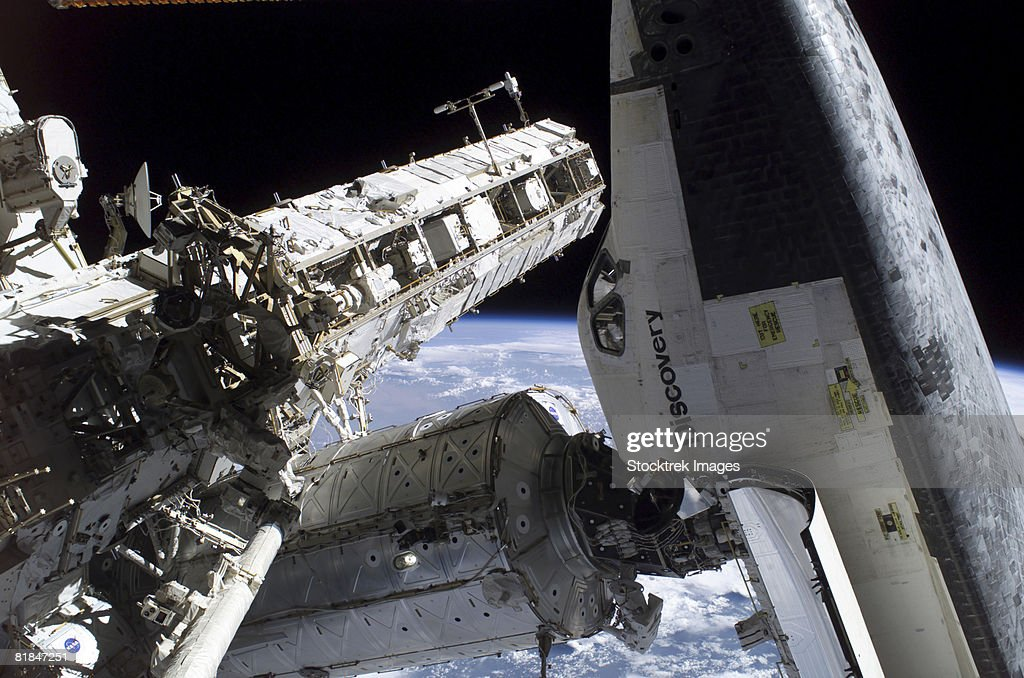 Space Shuttle docked to the International Space Station. : Stock Photo