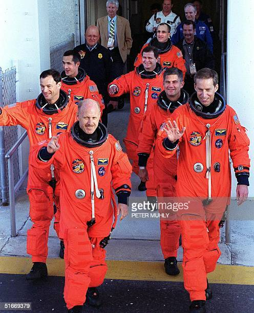 US space shuttle Endeavour and ISS Expedition 6 crews depart Kennedy Space Center's crew quarters 23 November 2002 for the ride to launch pad 39A to...