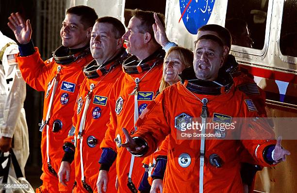 Space Shuttle Endeavour astronauts mission specialists Robert Behnken Nicholas Patrick Stephen Robinson and Kathryn Hire with pilot Terry Virts and...