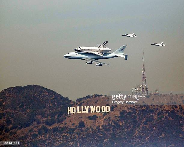 Space Shuttle Endeavour atop a NASA 747 Shuttle Carrier Aircraft passes over the Hollywood sign during its last farewell flight.