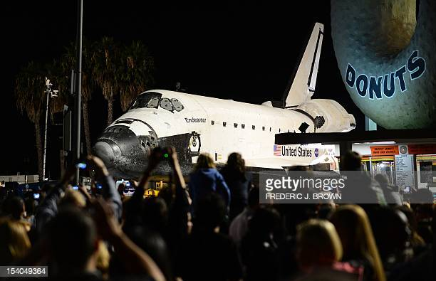 US space shuttle Endeavour attracts crowds before crossing Manchester Bridge above the 405 Freeway at La Cienega on its final journey through city...