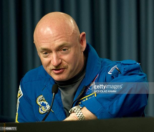 US space shuttle Endeavour commander Mark Kelly looks at his watch while answering a question about his wife Rep Gabrielle Giffords at a press...