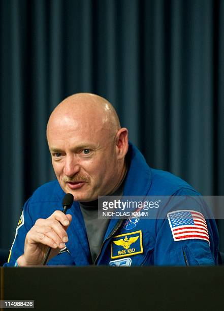 US space shuttle Endeavour Commander Mark Kelly speaks at a press conference at Kennedy Space Center in Florida on June 1 2011 Endeavour landed...