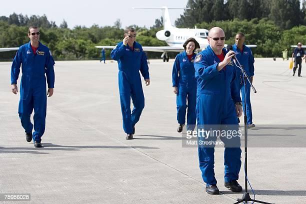 Space Shuttle Endeavour Commander Scott J Kelly addresses the media as mission specialists Alvin Drew Jr former teacher Barbara R Morgan Canadian...