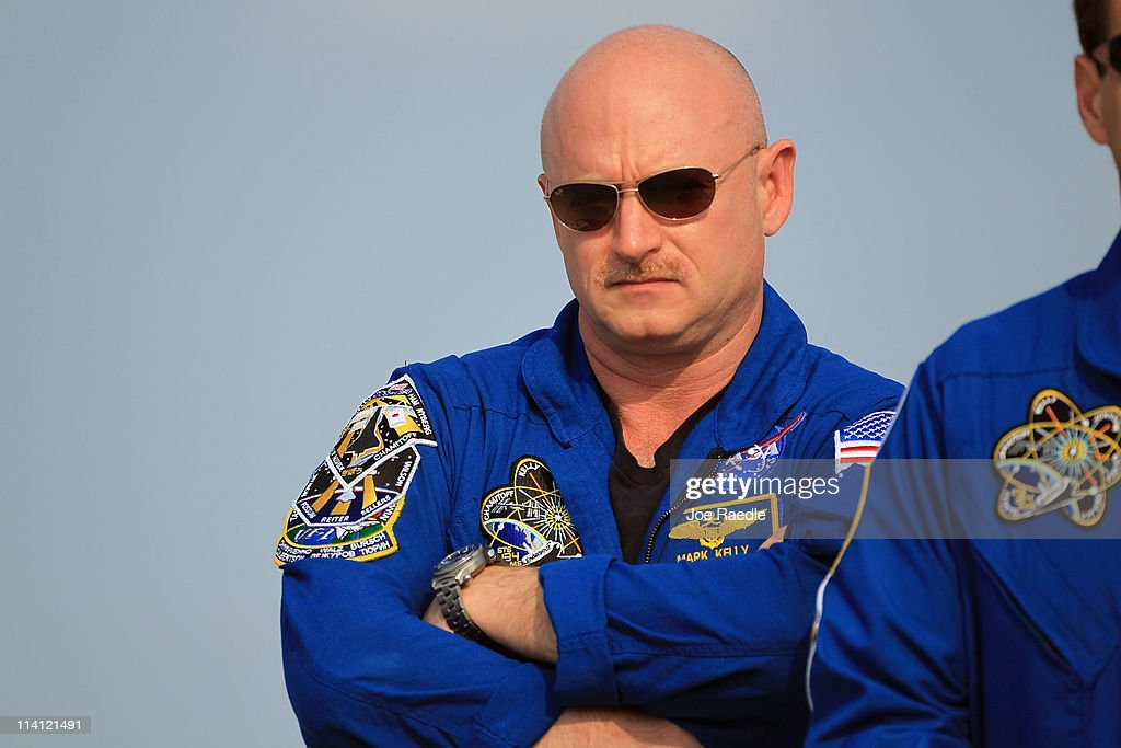 Space shuttle Endeavour crew Commander Mark Kelly stands on the tarmac after he arrived at Kennedy Space Center on May 12, 2011 in Cape Canaveral, Florida. Commander Kelly's wife, congresswoman Gabrielle Giffords, who was shot in the head at a meet-and-greet in her hometown of Tucson, Arizona, plans on attending the launch. Space shuttle Endeavour is scheduled to launch on its final flight to the space station on May 16th.