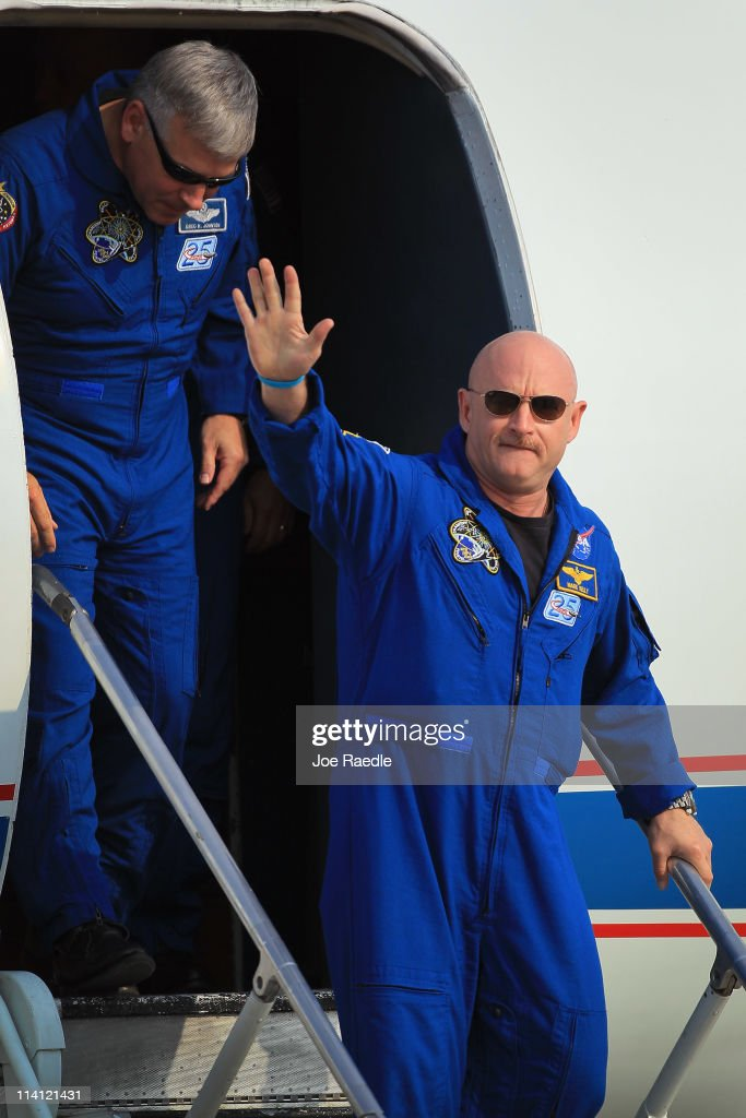 Space shuttle Endeavour crew Commander Mark Kelly waves as he walks off a plane with Pilot Gregory Johnson (L), after arriving at Kennedy Space Center on May 12, 2011 in Cape Canaveral, Florida. Commander Kelly's wife congresswoman Gabrielle Giffords, who was shot in the head at a meet-and-greet in her hometown of Tucson, Arizona, plans on attending the launch. Space shuttle Endeavour is scheduled to launch on its final flight to the space station on May 16th.