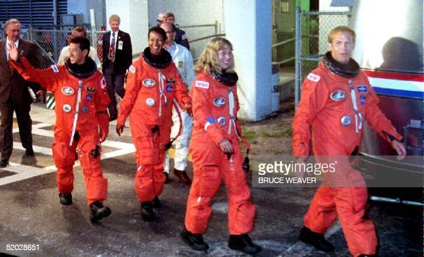 Space Shuttle Endeavour crew members Mamoru Mohri Japan's first astronaut to fly on the space shuttle Mae Jemison the first African American woman in...
