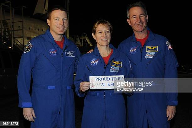 Space shuttle Endeavour STS130 crew hold a placard as post flight inspections are conducted after the crews return at Kennedy Space Center in Cape...